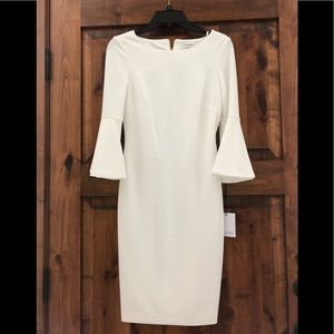 White Calvin Klein bell sleeve dress